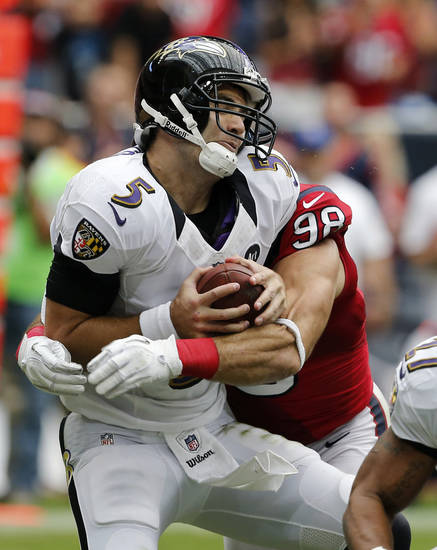Baltimore Ravens quarterback Joe Flacco (5) is sacked by Houston Texans outside linebacker Connor Barwin (98) during the first half of an NFL football game on Sunday, Oct. 21, 2012, Houston, Texas. (AP Photo/Waco Tribune Herald, Jose Yau)