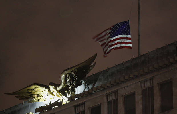 The U.S. flag flies at half staff at the U.S. Embassy in London in reaction to the shootings at Sandy Hook Elementary School in Connecticut, Saturday, Dec. 15, 2012. (AP Photo / Sang Tan) ORG XMIT: LST132