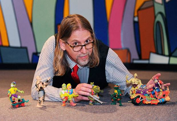 Kevin Stark poses with toys on display at the Toy and Action Figure Museum in Pauls Valley, Photo by Calli Henry