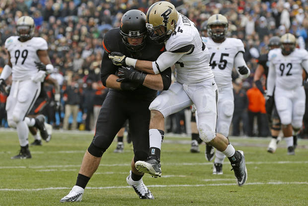 Oklahoma State's Jeremy Seaton (44) pushes past Purdue's Landon Feichter (44) to score a touchdown during the Heart of Dallas Bowl football game between Oklahoma State University and Purdue University at the Cotton Bowl in Dallas, Tuesday, Jan. 1, 2013. Oklahoma State won 58-14. Photo by Bryan Terry, The Oklahoman