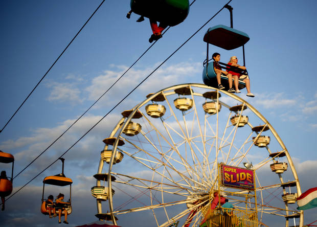 Visitors to the Oklahoma State Fair ride the tram on Wednesday, September 22, 2010.  Photo by Bryan Terry, The Oklahoman