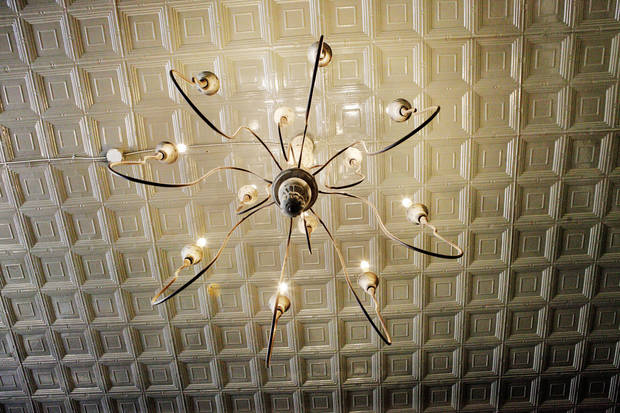 Chandelier and tin ceiling at Ludivine, 805 N Hudson, in Oklahoma City. <strong>PAUL B. SOUTHERLAND - THE OKLAHOMAN</strong>