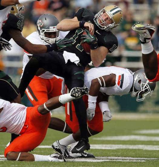 Baylor's Nick Florence (11) is stopped after keeping the ball for first down in the first quarter during a college football game between the Oklahoma State University Cowboys (OSU) and the Baylor University Bears at Floyd Casey Stadium in Waco, Texas, Saturday, Dec. 1, 2012. Photo by Nate Billings, The Oklahoman