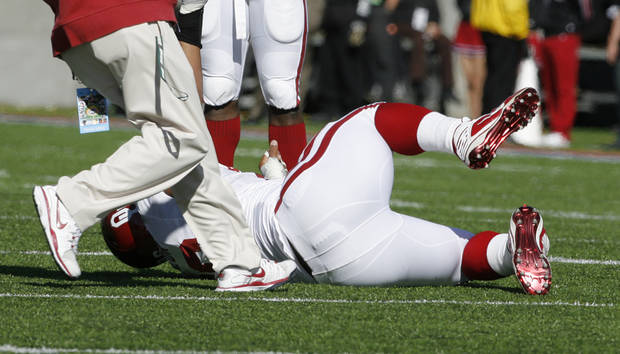 Ardian Taylor (86) is injured during the first half of the Brut Sun Bowl college football game between the University of Oklahoma Sooners (OU) and the Stanford University Cardinal on Thursday, Dec. 31, 2009, in El Paso, Tex.   Photo by Steve Sisney, The Oklahoman