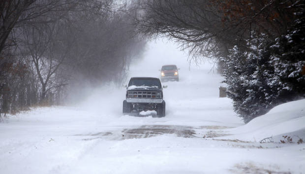 4 wheel drive vehicles drive through deep snow on E. Charter Oak Rd. in Logan County, Oklahoma February  1 , 2011. Photo by Steve Gooch, The Oklahoman
