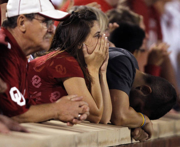 Sooner fans look on in the final seconds of the 24-19 loss to Oklahoma during the college football game between the University of Oklahoma Sooners (OU) and the Kansas State University Wildcats (KSU) at the Gaylord Family-Memorial Stadium on Saturday, Sept. 22, 2012, in Norman, Okla. Photo by Chris Landsberger, The Oklahoman