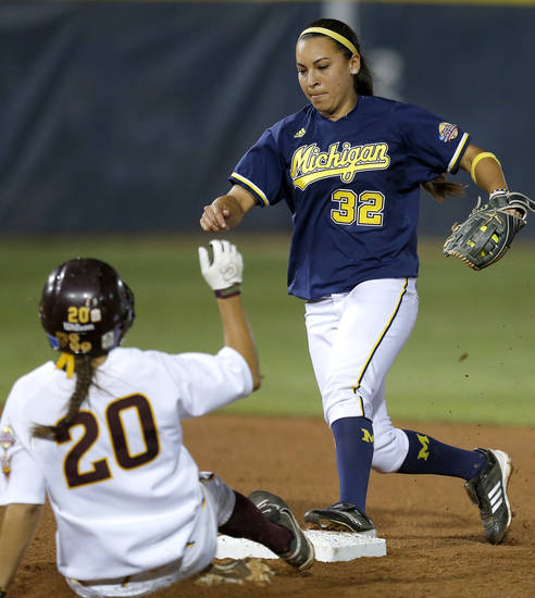Michigan's Sierra Romero forces out Arizona State's Sam Parlich in the second inning of their Women's College World Series softball game at ASA Hall of Fame Stadium in Oklahoma City, Sunday, June, 2, 2013. Photo by Bryan Terry, The Oklahoman