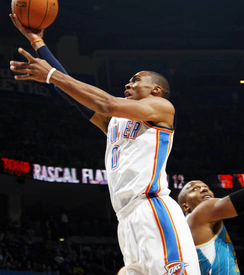 Oklahoma City's Russell Westbrook (0) takes a shot past David West (30) of New Orleans during the NBA basketball game between the New Orleans Hornets and the Oklahoma City Thunder at the Oklahoma City Arena in downtown Oklahoma City, Monday, Nov. 29, 2010. Photo by Nate Billings, The Oklahoman