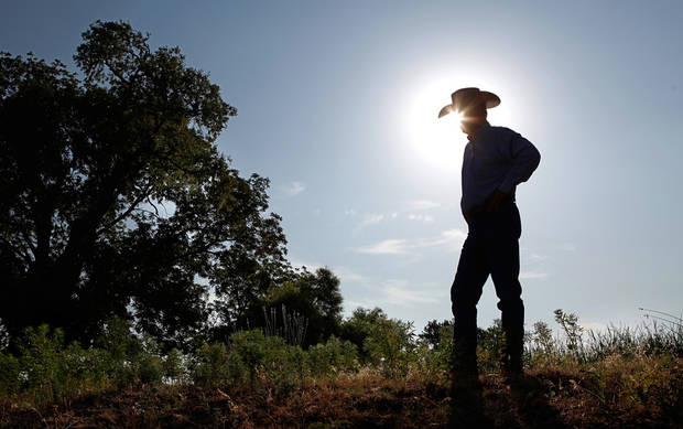 Wes Sander, cattle rancher, on his land just outside Woodward town limits on Tuesday, July 26, 2011.    Lack of rain and a string of days when temperatures exceeded  100 degrees have created extreme conditions for farmers, ranchers and citizens of many communities in western Oklahoma.  by Jim Beckel, The Oklahoman.