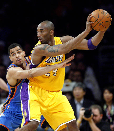 Oklahoma City's Thabo Sefolosha (2) defends Los Angeles' Kobe Bryant (24) during Game 4 in the second round of the NBA basketball playoffs between the L.A. Lakers and the Oklahoma City Thunder at the Staples Center in Los Angeles, Saturday, May 19, 2012. Photo by Nate Billings, The Oklahoman