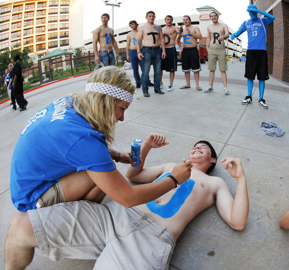 "Kaitlyn Rider of Oklahoma City paints the letter U on the chest of Caleb St. Laurent of Moore, Okla., so the he and his friends could spell ""Thunder Up!"" while watching game 3 of the Western Conference Finals of the NBA basketball playoffs between the Dallas Mavericks and the Oklahoma City Thunder from outside of the OKC Arena in downtown Oklahoma City, Saturday, May 21, 2011. Photo by Nate Billings, The Oklahoman"