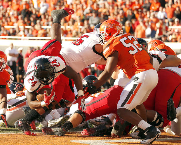 Texas Tech's Eric Stephens Jr. (24) dives in for a touchdown during a college football game between Oklahoma State University and the Texas Tech University (TTU) at Boone Pickens Stadium in Stillwater, Okla., Saturday, Nov. 17, 2012. Photo by Sarah Phipps, The Oklahoman