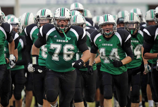 The Bishop McGuinness Fighting Irish, including Chip Daniel (76) and Jordan Edwards (44)  take the field before a high school football game between Millwood and Bishop McGuinness at Bishop McGuinness Catholic High School in Oklahoma City, Friday, Sept. 16, 2011. Photo by Nate Billings, The Oklahoman