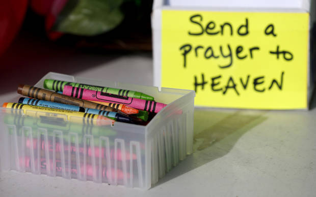 Crayons sit on a table outside of a barbershop a day after a gunman opened fire at Sandy Hook Elementary School, Saturday, Dec. 15, 2012, in the Sandy Hook village of Newtown, Conn.  The massacre of 26 children and adults at Sandy Hook Elementary school elicited horror and soul-searching around the world even as it raised more basic questions about why the gunman, 20-year-old Adam Lanza, would have been driven to such a crime and how he chose his victims.  (AP Photo/Julio Cortez) ORG XMIT: CTJC124