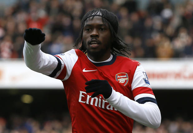 Arsenal's Gervinho celebrates scoring a goal during the English Premier League soccer match between Arsenal and Reading at the Emirates Stadium in London, Saturday, March 30, 2013. (AP Photo/Kirsty Wigglesworth)