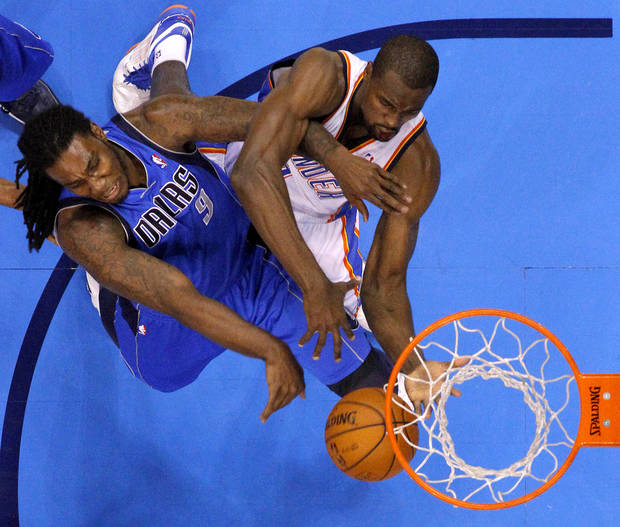 Oklahoma City's Serge Ibaka (9) goes for the ball beside Dallas' Jae Crowder (9) during an NBA basketball game between the Oklahoma City Thunder and the Dallas Mavericks at Chesapeake Energy Arena in Oklahoma City, Thursday, Dec. 27, 2012.  Oklahoma City won 111-105. Photo by Bryan Terry, The Oklahoman