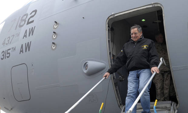 U.S. Defense Secretary Leon Panetta walks off of his plane after arriving at Kandahar Airfield in Kandahar, Afghanistan, Thursday, Dec. 13, 2012. (AP Photo/Susan Walsh, Pool)