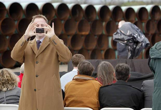 State Rep. Cory Williams of Stillwater takes a photo before the arrival of President Barack Obama at the TransCanada Pipe Yard near Cushing, Okla., Thursday, March 22, 2012. Photo by Nate Billings, The Oklahoman