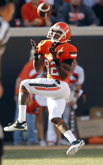 Oklahoma State&#039;s Isaiah Anderson (82) catches a pass for a touchdown during a college football game between Oklahoma State University and the Texas Tech University (TTU) at Boone Pickens Stadium in Stillwater, Okla., Saturday, Nov. 17, 2012. Photo by Sarah Phipps, The Oklahoman