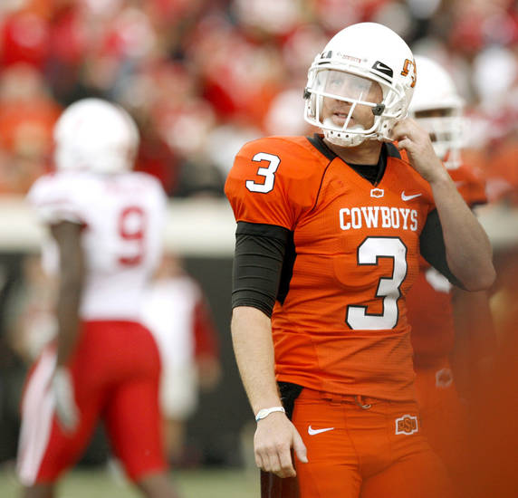 OSU's Brandon Weeden walks back to the sidelines during the college football game between the Oklahoma State Cowboys (OSU) and the Nebraska Huskers (NU) at Boone Pickens Stadium in Stillwater, Okla., Saturday, Oct. 23, 2010. Photo by Bryan Terry, The Oklahoman