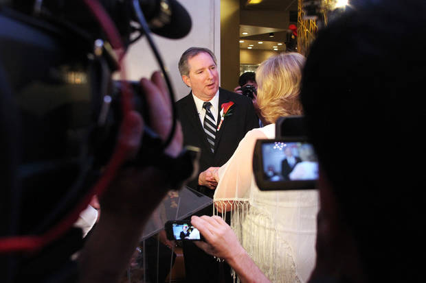 Ames, Iowa residents Nancy Levindowski and Steve Keller exchange wedding vows at the Denny's restaurant on Fremont Street in Las Vegas, Wednesday, April 4, 2013. (AP Photo/Las Vegas Sun, Sam Morris)