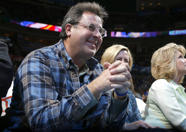 Singer Vince Gill watches the NBA game between the Oklahoma City Thunder and the Philadelphia 76ers at the Chesapeake Energy Arena in Oklahoma City, Friday,Jan. 4, 2013. Photo by Sarah Phipps, The Oklahoman