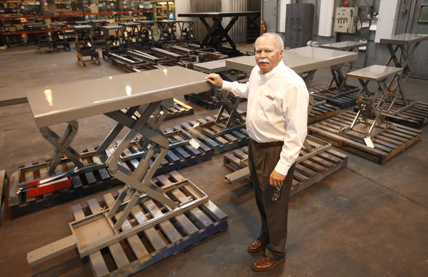 Autoquip President Joe Robillard shows some of the hydraulic lifts at the production plant in Guthrie, OK, Tuesday, February 5, 2013,  By Paul Hellstern, The Oklahoman