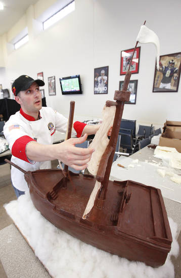 Food Service Specialist Adam Hermann puts the finishing touches on a chocolate Mayflower for Thanksgiving dinner at Garcia Dinning Hall at Fort Sill, Wednesday, November 21, 2012. Photo By David McDaniel/The Oklahoman