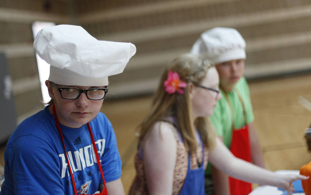 Channing Nessmith (left), 12, participates with Lauren Couch, 12, and Cort Hussong, 12, during Snack Wars at the YMCA in downtown Oklahoma City, Saturday, June 23, 2012.  Photo by Garett Fisbeck, The Oklahoman