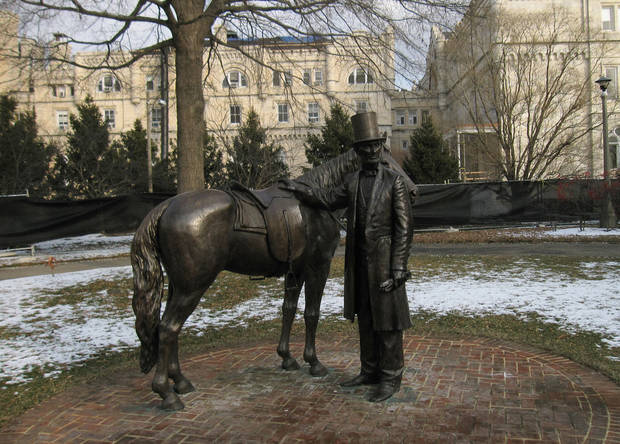 This Jan. 27, 2012 image shows a statue of President Lincoln on his horse outside President Lincoln�s Cottage, a historic site in Washington D.C. Lincoln summered here with his family and often commuted a half-hour on horseback to the White House each day. The cottage is one of a number of Lincoln sites that can be visited in Washington, D.C. (AP Photo/Beth J. Harpaz)