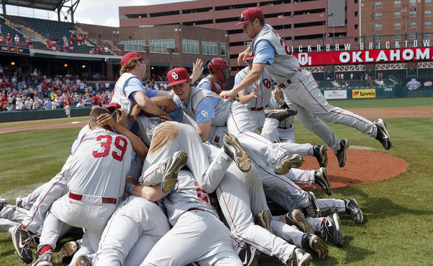 Oklahoma celebrates the 7-2 win over Kansas in the Big 12 Championship baseball game between the University of Kansas Jayhawks (KU) and the University of Oklahoma Sooners (OU) at the Chickasaw Bircktown Ballpark on Sunday, May 26, 2013 in Oklahoma City, Okla.  Photo by Chris Landsberger, The Oklahoman
