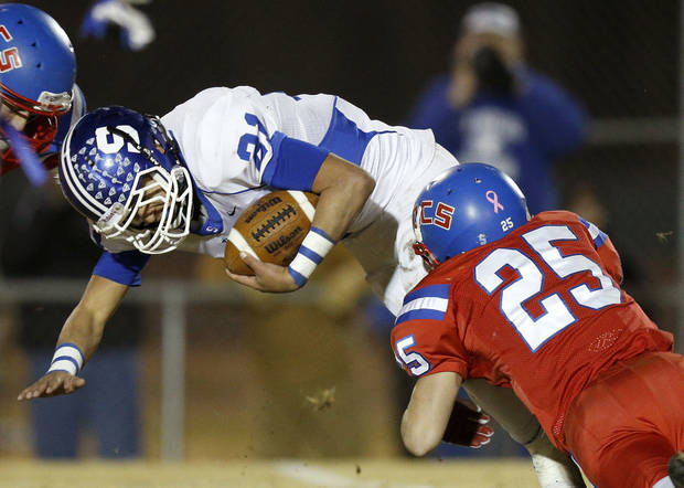 Stroud&#039;s Ryan McElvany is brought down by Oklahoma Christian School&#039;s Luke Frankfurt runs against Oklahoma Christian School during a high school football playoff game in Edmond, Friday, Nov. 23, 2012. Photo by Bryan Terry The Oklahoman