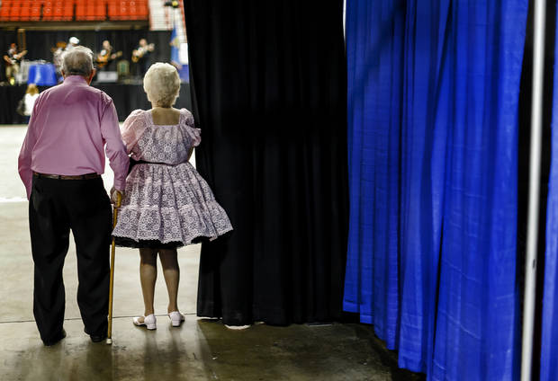 Square dance participants Gordon and Irma Schutt of Wichita, Kan. get a peek a the arena floor during the Square Dance Convention at the Cox Convention Center on Thursday, June 27, 2013, in Oklahoma City, Okla.Photo by Chris Landsberger, The Oklahoman