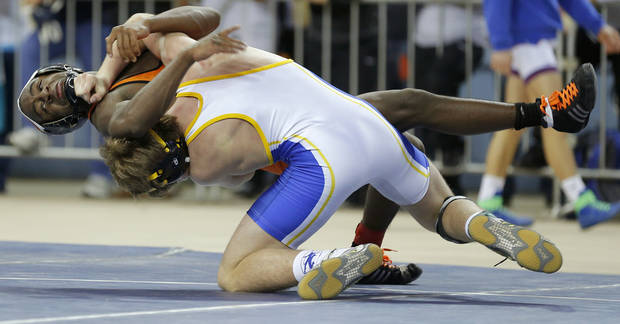 Putnam City's Keegan Moore, left,  wrestles Stillwater's Joe Smith in the Class 6A 132-pound championship match of the state wrestling championships at the State Fair Arena in Oklahoma City, Saturday, Feb. 23, 2013. Photo by Bryan Terry, The Oklahoman