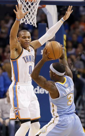 Oklahoma City's Russell Westbrook (0) defends on Denver's Ty Lawson (3) during the NBA basketball game between the Oklahoma City Thunder and the Denver Nuggets at the Chesapeake Energy Arena on Wednesday, Jan. 16, 2013, in Oklahoma City, Okla.  Photo by Chris Landsberger, The Oklahoman