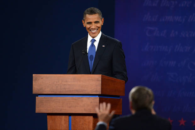 President Barack Obama smiles at moderator Jim Leher during the first presidential debate with former Massachusetts Governor Mitt Romney at the University of Denver Wednesday, Oct. 3, 2012, in Denver. (AP Photo/The Denver Post, Craig F. Walker) MAGS OUT; TV OUT; INTERNET OUT ORG XMIT: CODEN216