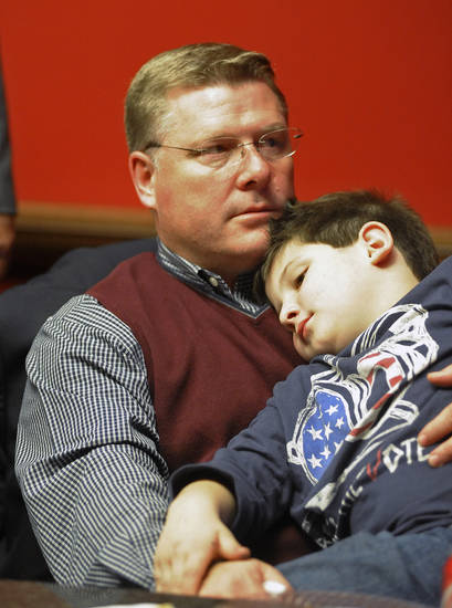 U.S. Rep. Rick Crawford, left, Arkansas' 1st District, R-Jonesboro, holds his son, Will, and monitors election night results on Tuesday, Nov. 6, 2012, in the Arkansas State University Cooper Alumni Center in Jonesboro, Ark. (AP Photo/The Jonesboro Sun, Saundra Sovick)