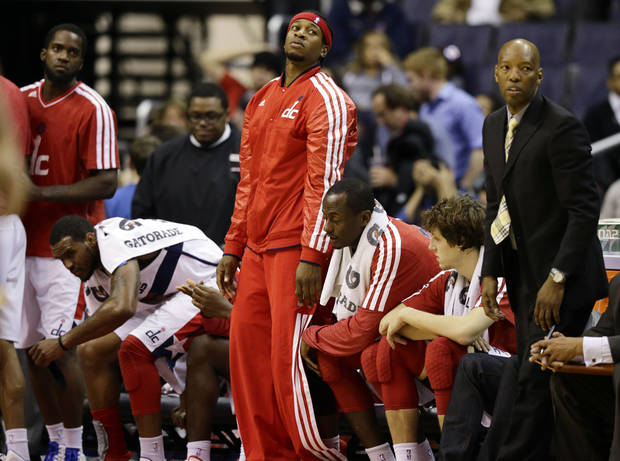 Washington Wizards forward Cartier Martin, center, stands up to leave as an NBA basketball against the Indiana Pacers ends on Monday, Nov. 19, 2012, in Washington. The Pacers won 96-89, handing the Wizards their ninth loss of the season. (AP Photo/Alex Brandon)