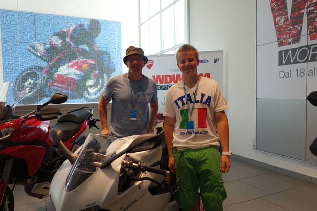 Darrell and Mitchell Bull pose among Ducati motorcycles. (Photo by Tricia Tramel)