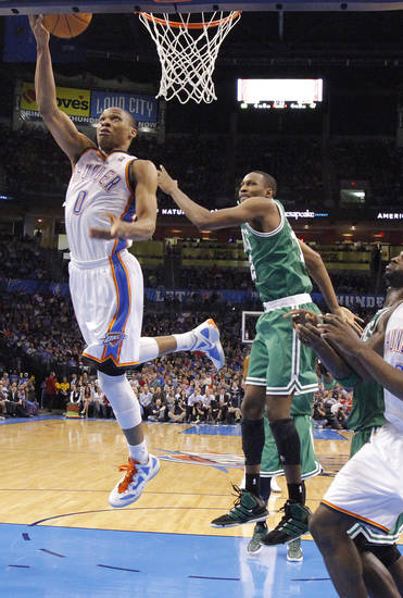 Oklahoma City Thunder point guard Russell Westbrook (0) drives past Boston Celtics forward JaJuan Johnson (12) during the NBA basketball game between the Oklahoma City Thunder and the Boston Celtics at the Chesapeake Energy Arena on Wednesday, Feb. 22, 2012 in Oklahoma City, Okla.  Photo by Chris Landsberger, The Oklahoman
