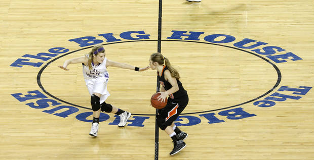 Okarche's Kenadey Grellner defends Cheyenne's Morgan Latta during the Class A girls state championship game between Okarche and Cheyenne/Reydon in the State Fair Arena at State Fair Park in Oklahoma City, Saturday, March 2, 2013. Photo by Bryan Terry, The Oklahoman