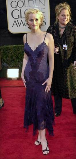 Reese Witherspoon, nominated for best actress in a motion picture comedy/musical for her work in Legally Blonde, arrives at the 59th Annual Golden Globe Awards in Beverly Hills, Calif., Sunday, Jan. 20, 2002.  (AP Photo/Laura Rauch)