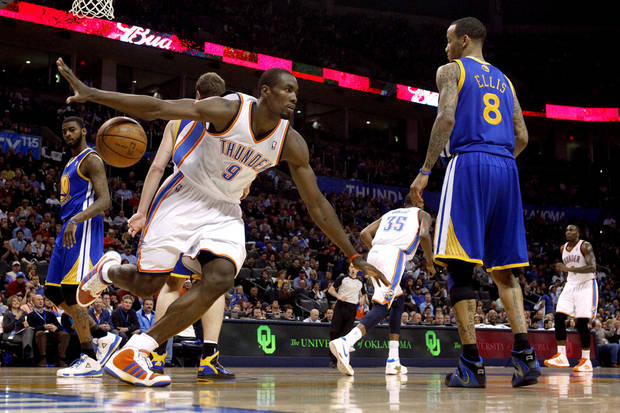 Oklahoma City's Serge Ibaka (9) celebrates between Golden State's Dorell Wright (1) and Golden State's Monta Ellis (8) during the NBA basketball game between the Oklahoma City Thunder and the Golden State Warriors at the Oklahoma City Arena, Tuesday, March 29, 2011. Photo by Bryan Terry, The Oklahoman