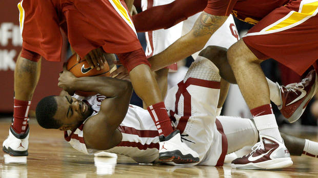 Oklahoma's Sam Grooms (1) fight for the ball during an NCAA basketball game between the University of Oklahoma Sooners (OU) and the Iowa State Cyclones (ISU) at the Lloyd Noble Center in Norman, Saturday, Feb. 4, 2012. Photo by Bryan Terry, The Oklahoman