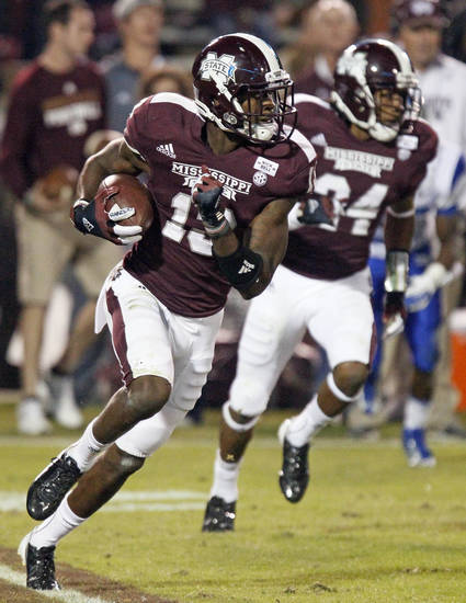 Mississippi State defensive back Johnthan Banks (13) returns a punt for 15 yards in the third quarter as teammate Jamerson Love (24) provides blocking in their NCAA college football game against Middle Tennessee State in Starkville, Miss., Saturday, Oct. 20, 2012. No. 15 Mississippi State won 45-3. (AP Photo/Rogelio V. Solis)  ORG XMIT: MSRS116