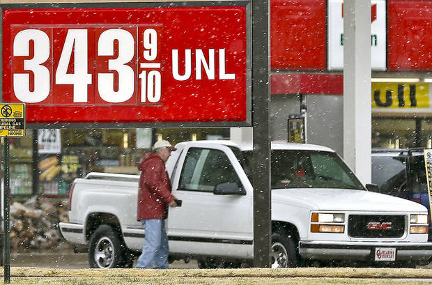 Drivers line up at gasoline pumps as snow falls Monday in Oklahoma City. Photo by Chris Landsberger, The Oklahoman