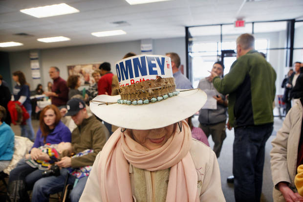 Joyce Verplank Hatton of Spring Lake wears a hat supporting presidential candidate Mitt Romney while attending a rally with his sons, Matt and Josh Romney, on Monday, Nov. 5 at the Kent County Republican Party Headquarters. Verplank Hatton worked for George Romney's national campaign in 1968. (AP Photo/Grand Grapids Press, Emily Zoldaz) ALL LOCAL TV OUT; LOCAL TV INTERNET OUT