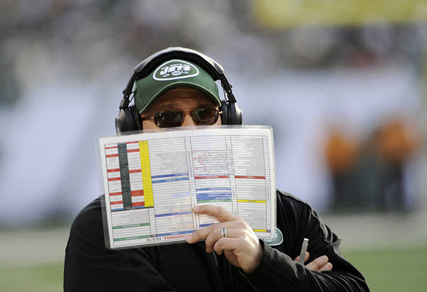 FILE - This Dec. 2, 2012 file photo shows New York Jets offensive coordinator Tony Sparano holding a play list during the first half of an NFL football game against the Arizona Cardinals in East Rutherford, N.J. Sparano has been fired as the Jets' offensive coordinator, Tuesday, Jan. 8, 2013,  after one season in which the offense ranked among the league's worst. (AP Photo/Bill Kostroun, File)