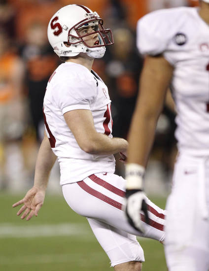 Stanford kicker Jordan Williamson watches his missed field goal against Oklahoma State during overtime of the Fiesta Bowl NCAA college football game Monday, Jan. 2, 2012, in Glendale, Ariz. Oklahoma State won 41-38 in overtime. (AP Photo/Paul Connors)  ORG XMIT: PNP156