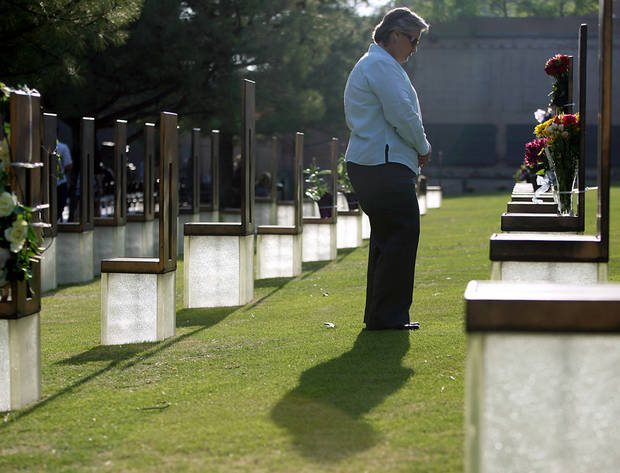 Karen Worth stands near a chair dedicated to her friend Jill Randolph, during the 16th Annual Day of Remembrance at the Oklahoma City National Memorial and Museum in Oklahoma City, Oklahoma onTuesday, April 19, 2011. Photo by John Clanton, The Oklahoman